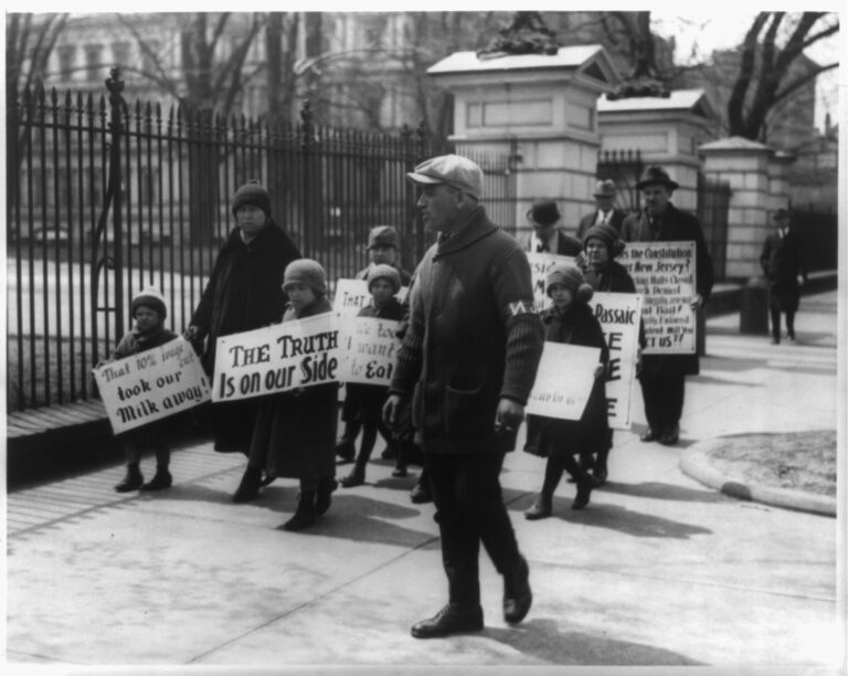 Four adults and six children, from Passaic, N.J., picket the White House following President Coolidge's refusal to listen to their complaints about wage cuts in the textile industry