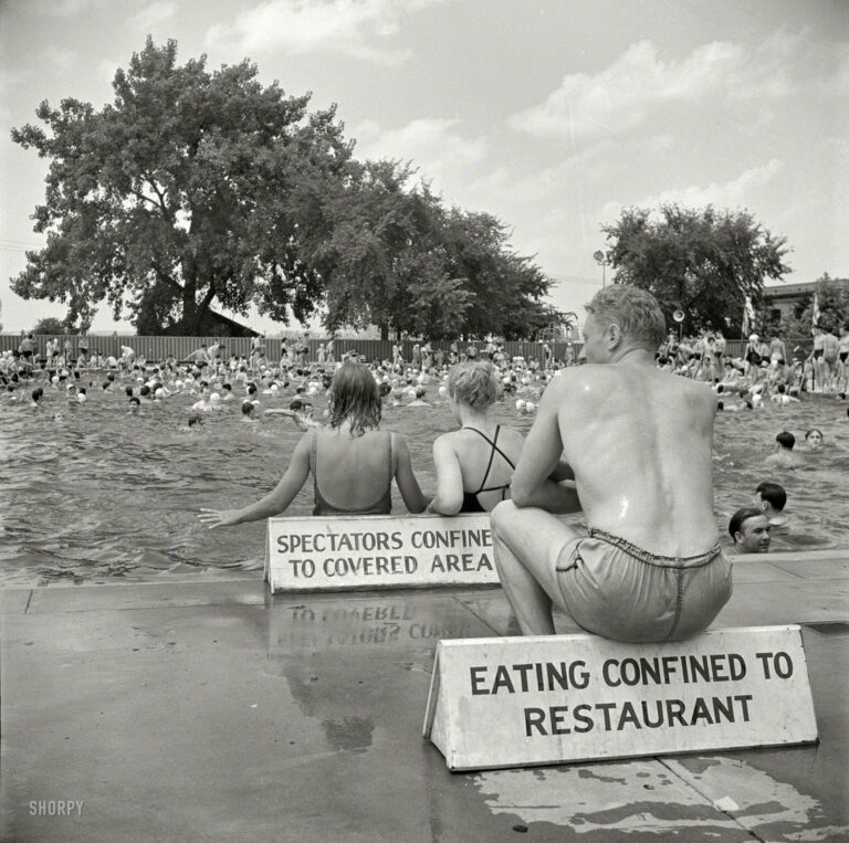 "July 1942. Washington, D.C. ""Municipal swimming pool on Sunday."" Remember: Sitting confined to sign. Photo by Marjory Collins for the OWI."