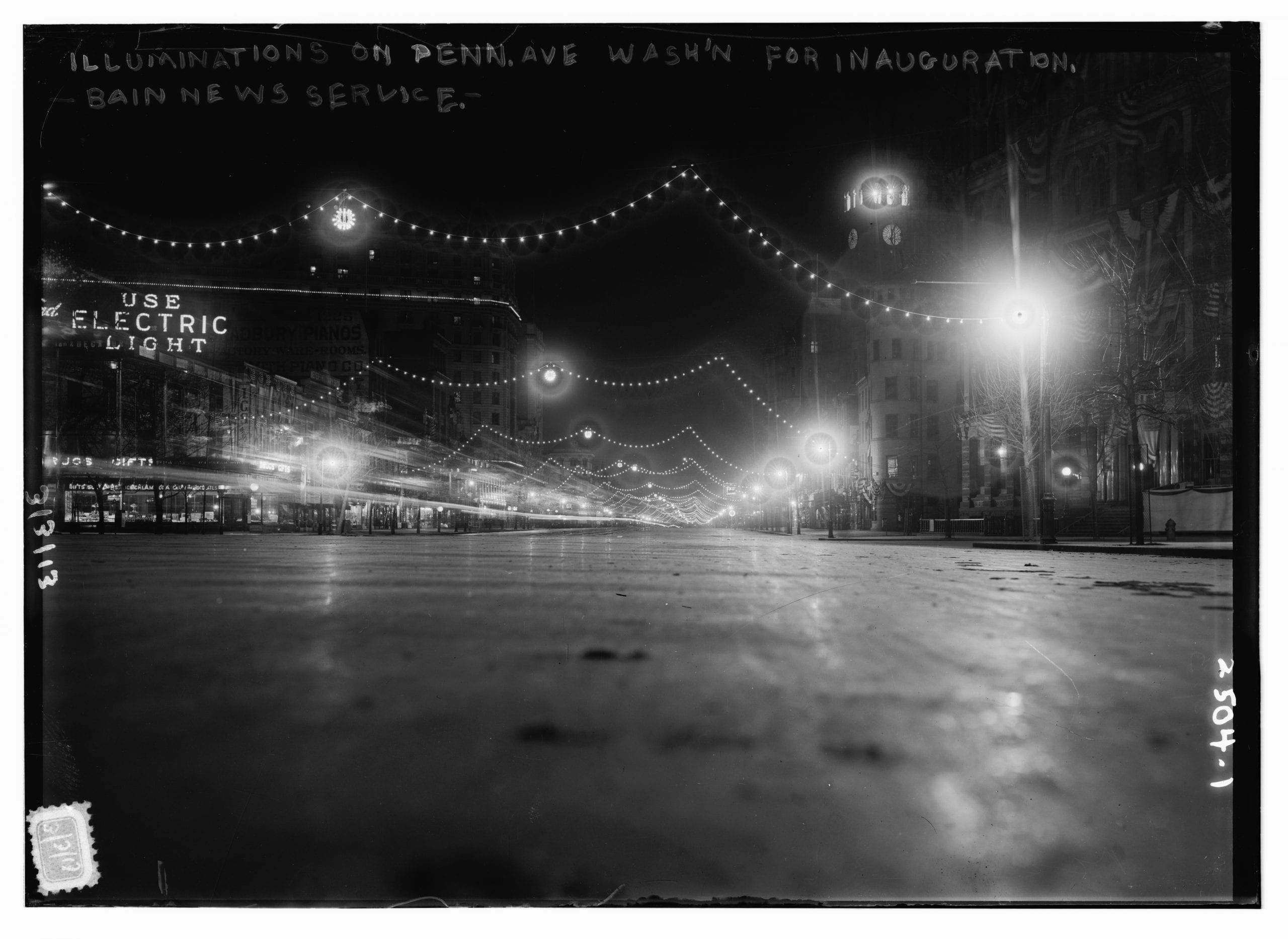 Photo shows night view of Pennsylvania Avenue in Washington, D.C., decorated with electric lights for the first inauguration of President Woodrow Wilson. (Source: Flickr Commons project, 2008)