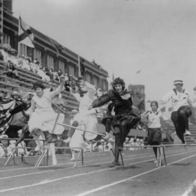 Women competing in low hurdle race