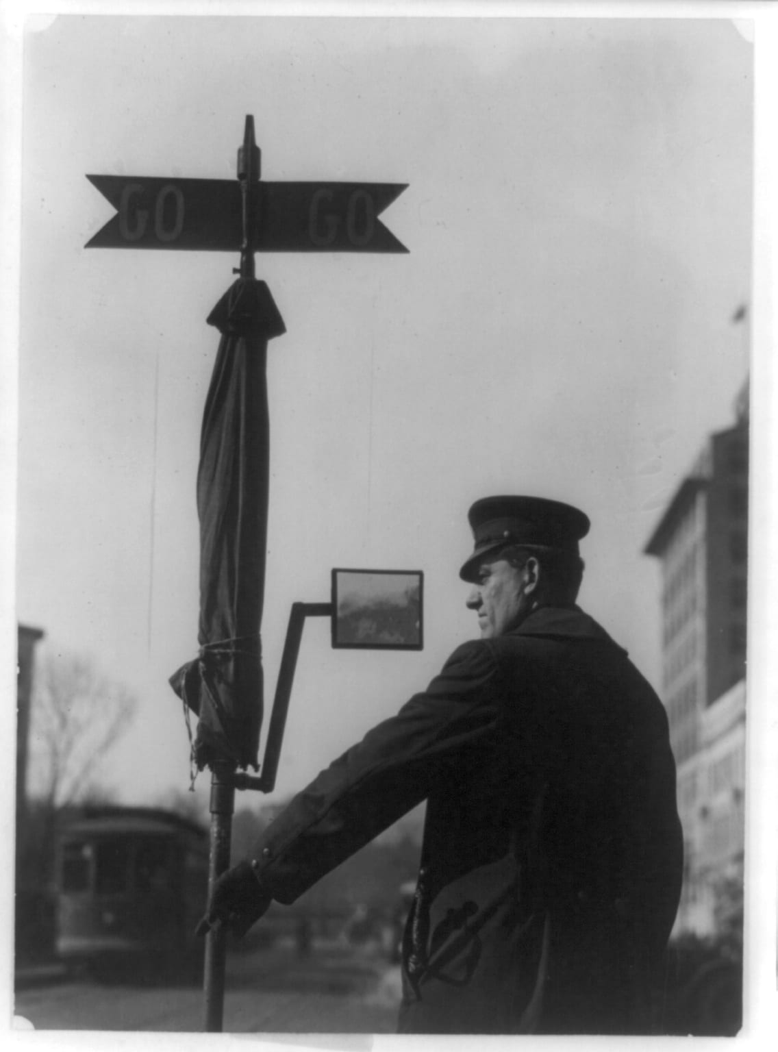 Policeman using mirror to direct traffic at 14th St. and Pennsylvania Avenue