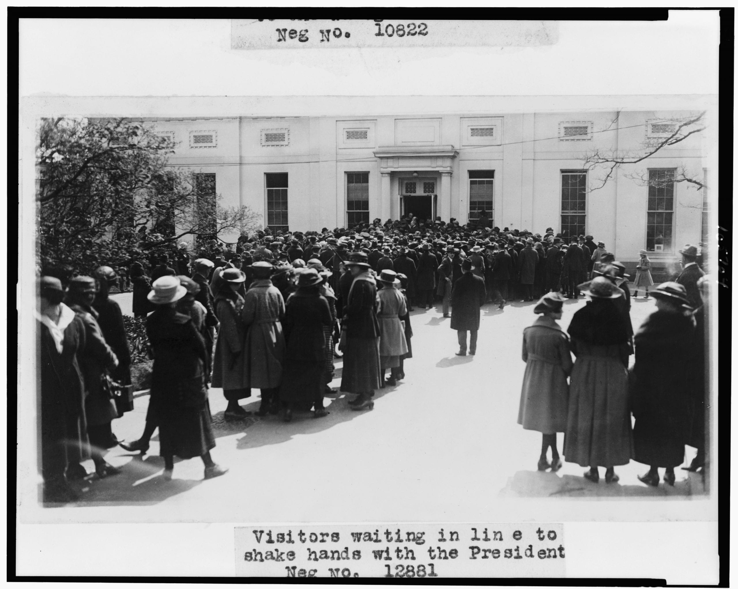 Visitors waiting in line to shake hands with the President (circa 1921)