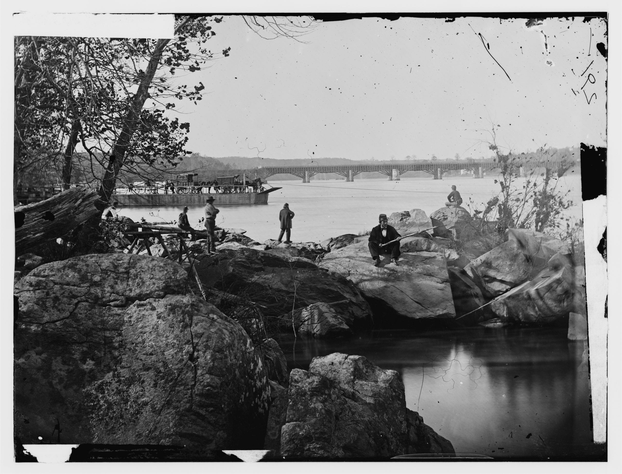 Washington, D.C. Georgetown ferry-boat carrying wagons, and Aqueduct Bridge beyond, from rocks on Mason's Island (Library of Congress)