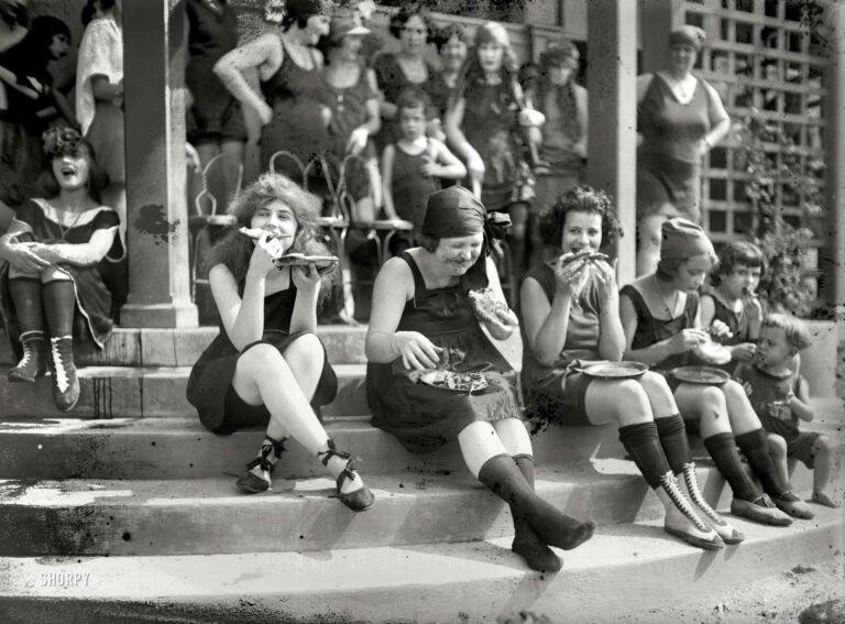 """July 31, 1921. Washington, D.C. """"Pie eating contest at Tidal Basin bathing beach."""" In the back row: the blurry but unmistakable facial contours of Iola Swinnerton. National Photo Company Collection glass negative."""