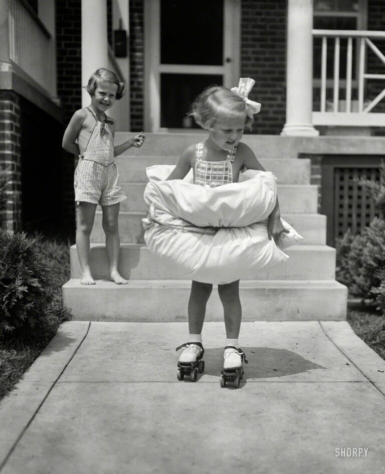 """Aug. 8, 1936. Washington, D.C. """"Safety first for this Miss. Equipped with bumpers fore and aft, 4-year-old Betty Buck is taking no unnecessary chances as she tries her first pair of roller skates."""" Harris & Ewing glass negative."""
