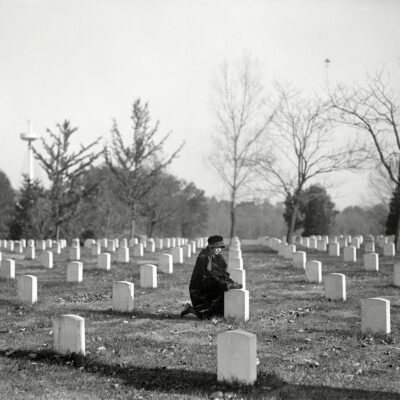 """""""Arlington National Cemetery, 1922."""" With the USS Maine Memorial rising at left. Harris & Ewing Collection glass negative."""
