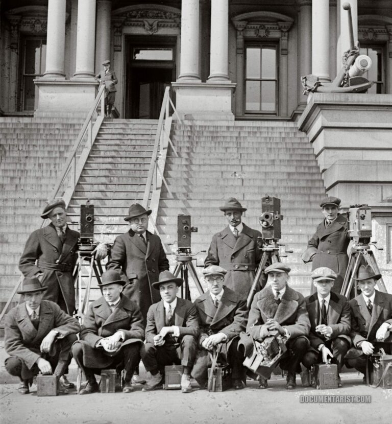 cameramen posing in front of the State, War, and Navy Building