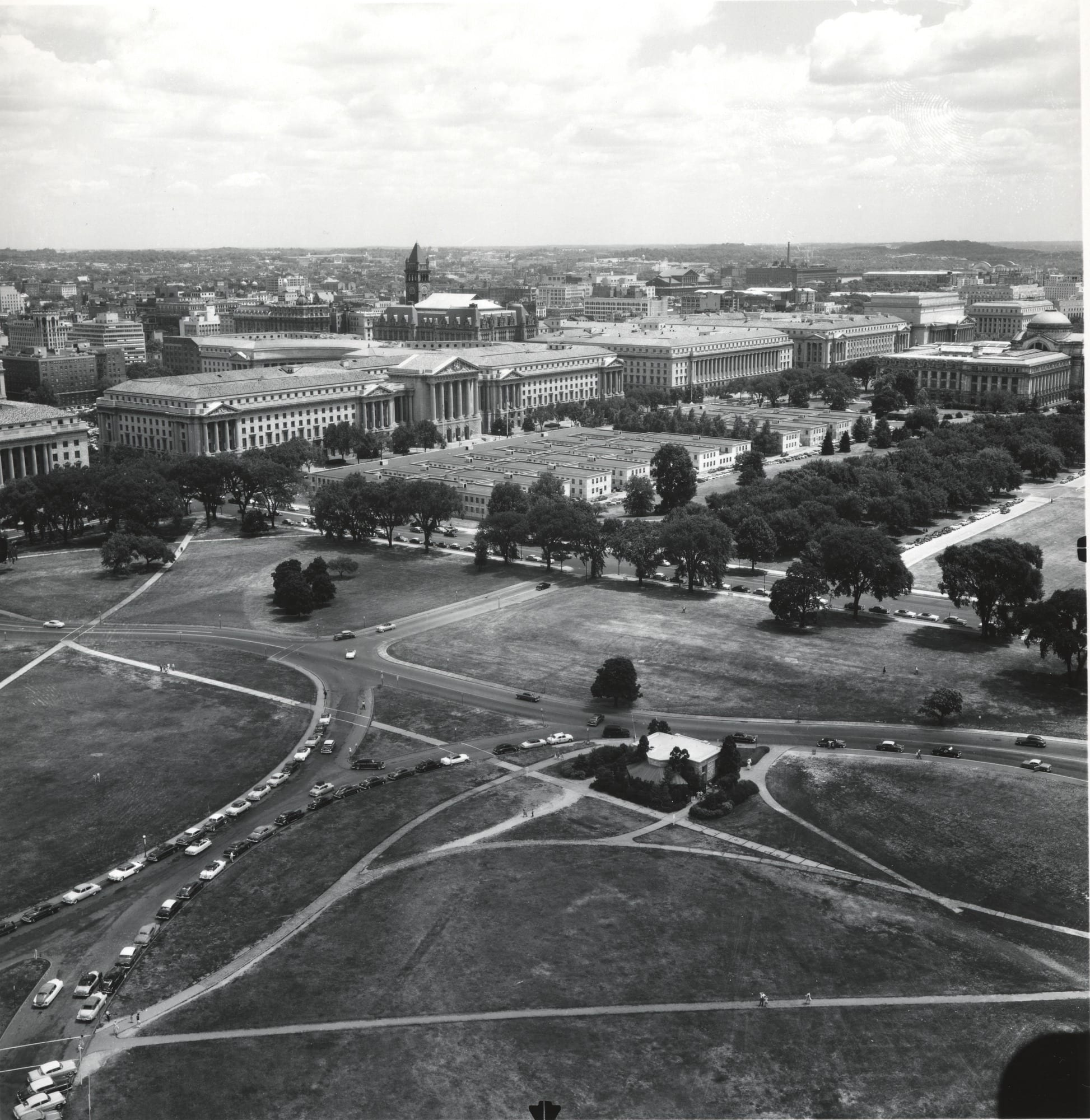 "Aerial view from the Washington Monument showing the ""Tempos"" or temporary buildings before their demolition. They were located on the site of the future National Museum of History and Technology (NMHT), now the National Museum of American History (NMAH)"