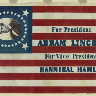 """Print shows a large campaign banner for Republican presidential candidate Abraham Lincoln and running mate Hannibal Hamlin. Lincoln's first name is given here as """"Abram."""" The banner consists of a thirty-three star American flag pattern printed on cloth. In one corner, a bust portrait of Lincoln, without beard, encircled by stars, appears on a blue field."""