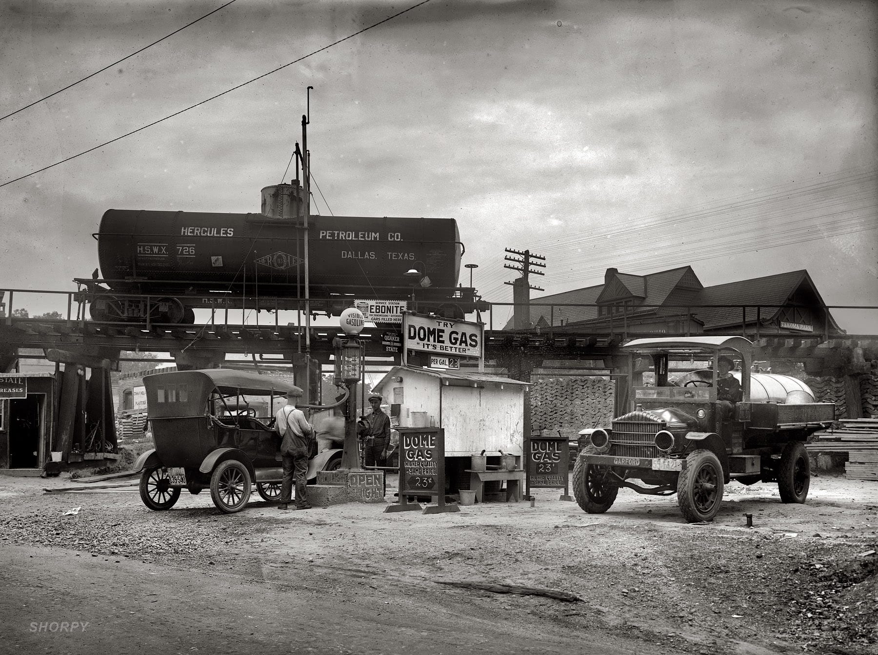 """""""Dome Oil Co., Takoma Park."""" In Maryland in 1921, a gritty diorama of the Petroleum Age."""
