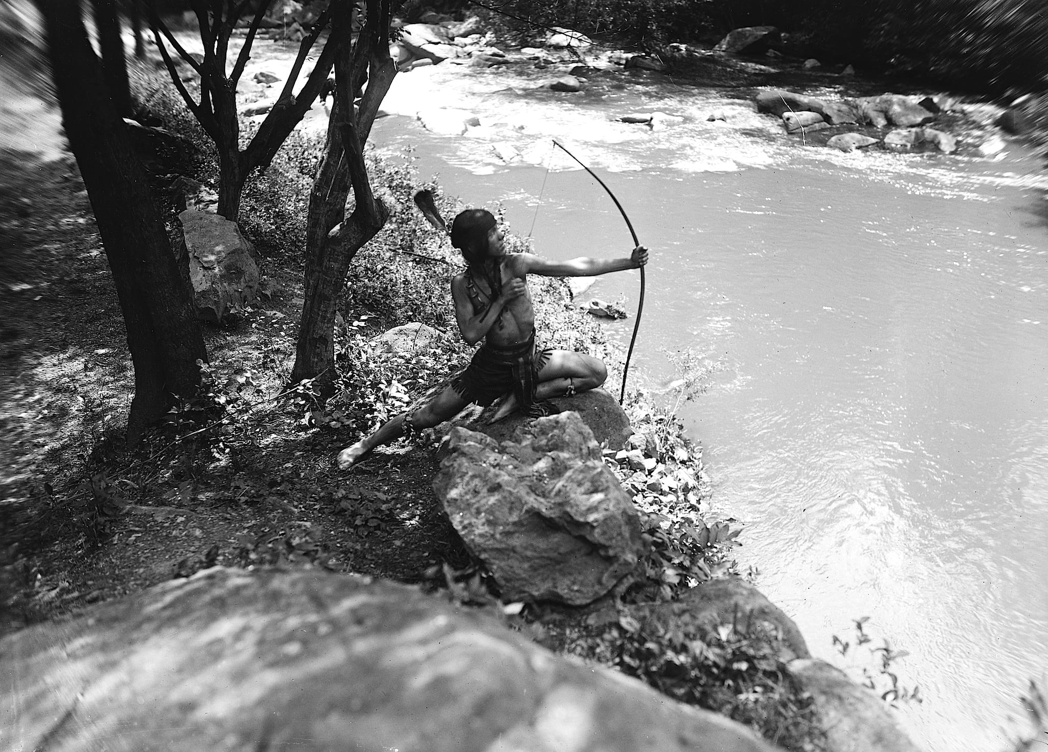 Native American Shoots Bow and Arrow Near Rock Creek