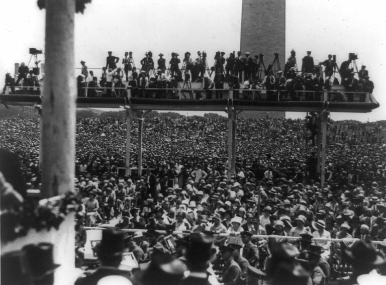 Photographers on platform above crowd at Charles A. Lindbergh speech at the Washington Monument in Washington, D.C.