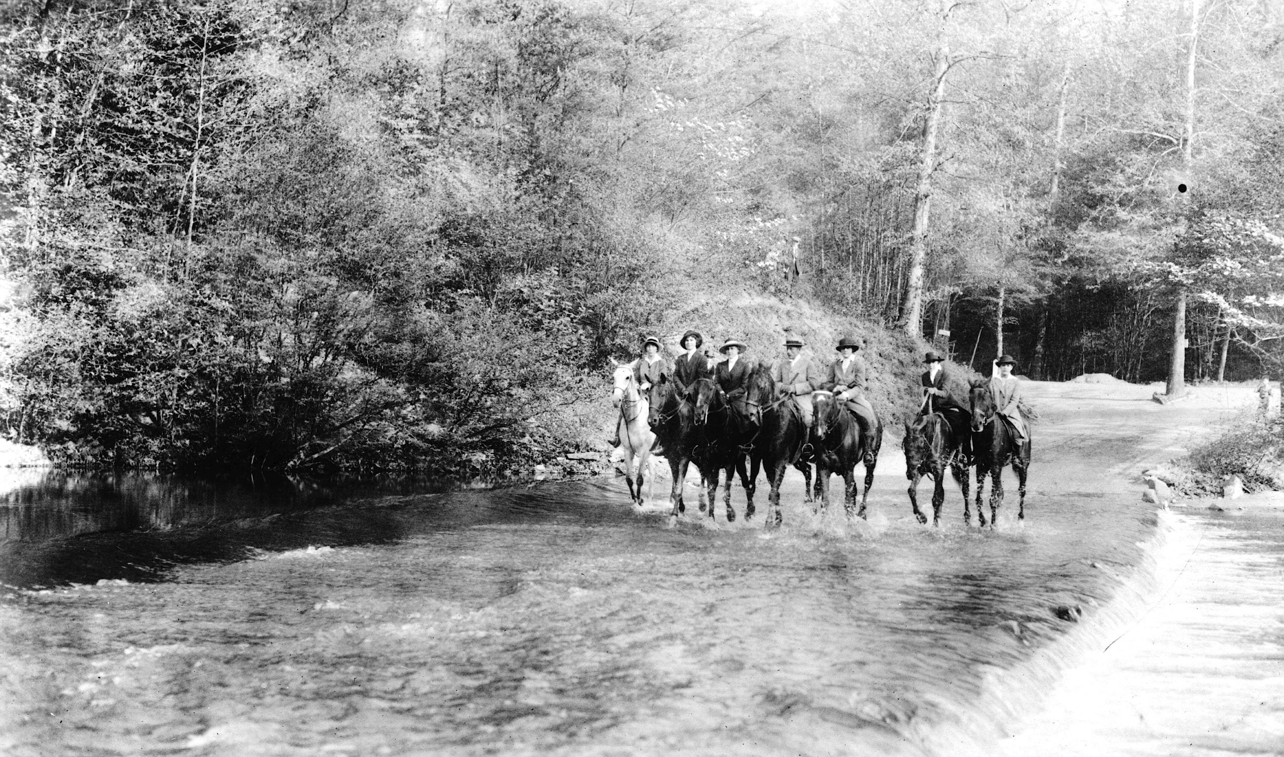 riders on horseback crossing Rock Creek