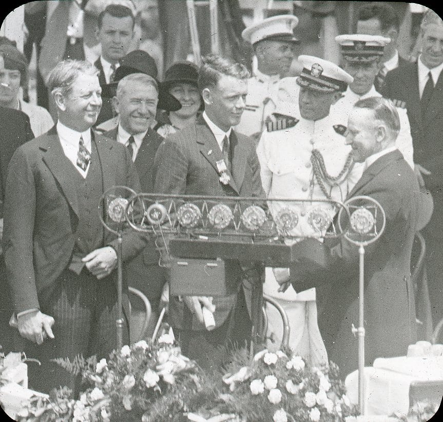 Charles Lindbergh receiving the Distinguished Flying Cross from President Calvin Coolidge, June 11, 1927