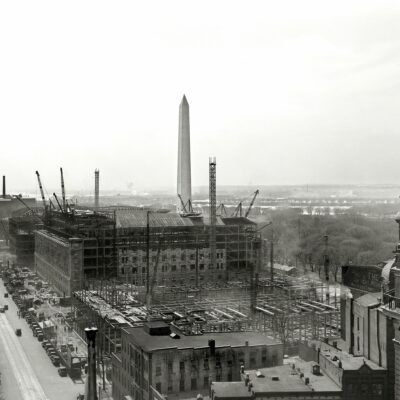 "Washington, D.C., circa 1931. ""Department of Commerce under construction from top of National Press Building looking down 14th Street."" Willard Hotel at right. Large format negative by Theodor Horydczak."