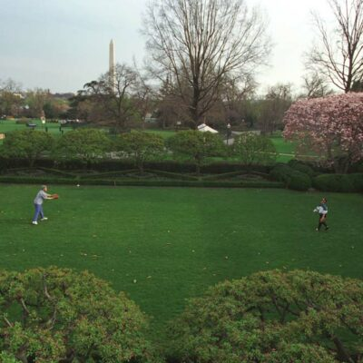 William Jefferson Clinton and Hillary Rodham Clinton play catch in the Rose Garden. They are practicing for upcoming opening pitch ceremonies that both of them will participate in. 4/3/94.