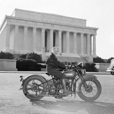 First of fair sex to obtain motorcycle license in Capital. Washington, D.C., Sept. 15. Although she weights only 88 pounds--one-third of the machine she rides, Mrs. Sally Halterman is the first woman to be granted a license to operate a motorcycle in the District of Columbia. She is 27 years old and 4 feet, 11 inches tall. Immediately after receiving her permit, Mrs. Halterman was initiated into the D.C. Motorcycle Club - the only girl ever to be accorded this honor