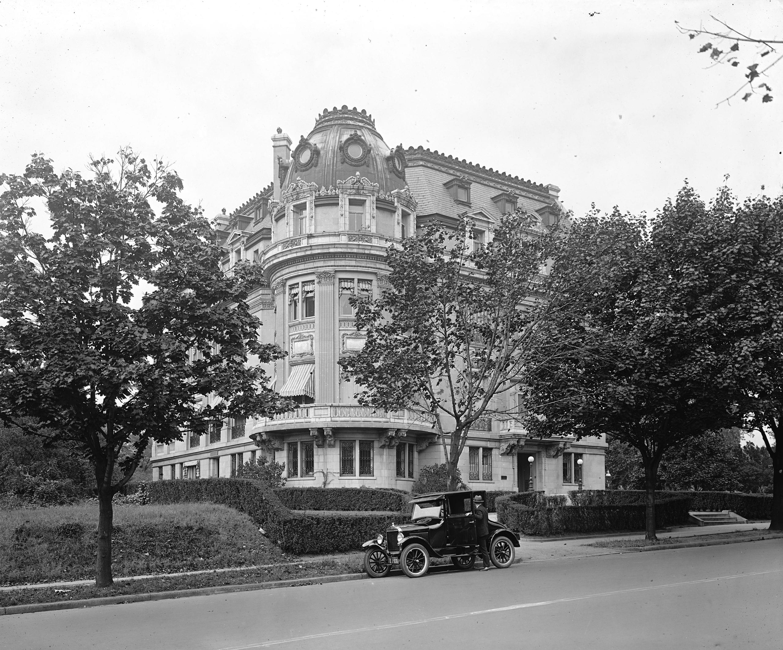 Ford motor car in front of the French Embassy