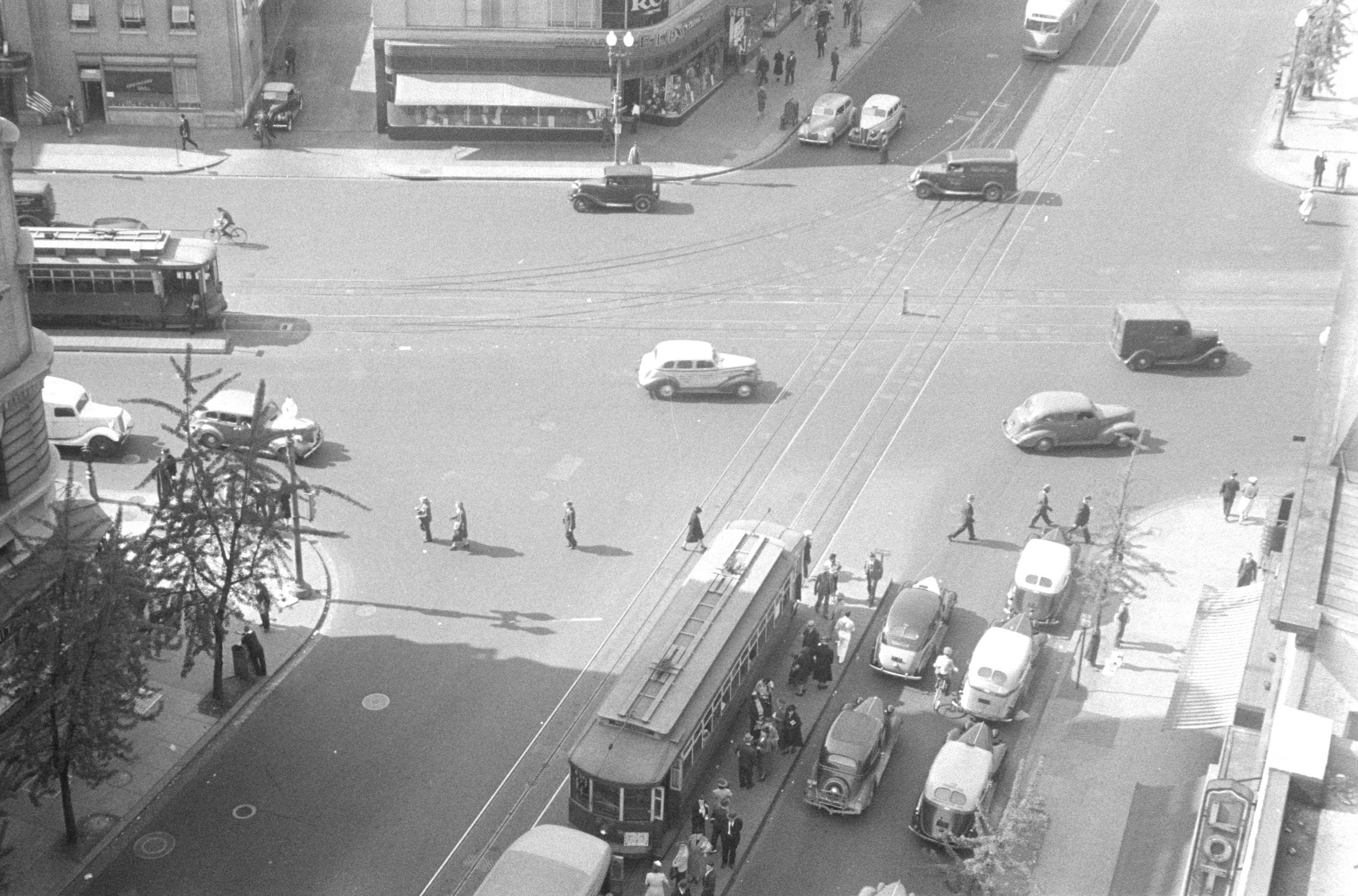 Washington, D.C. A street scene showing street cars crossing at 14th Street and New York Avenue, photographed from a building near the Lotus Club