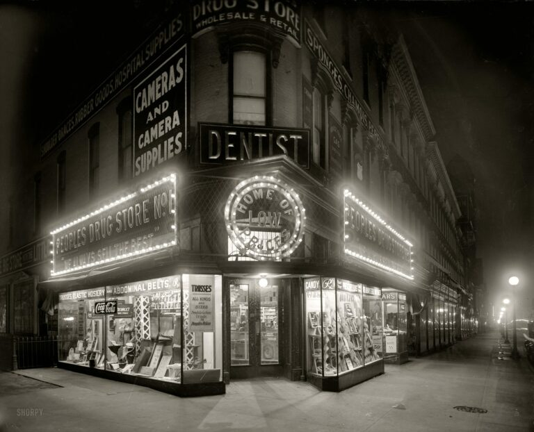 """Washington, D.C., circa 1921. """"People's Drug Store, Seventh & K, night."""" With a lurid display of """"trusses and rubber goods."""" National Photo Co."""