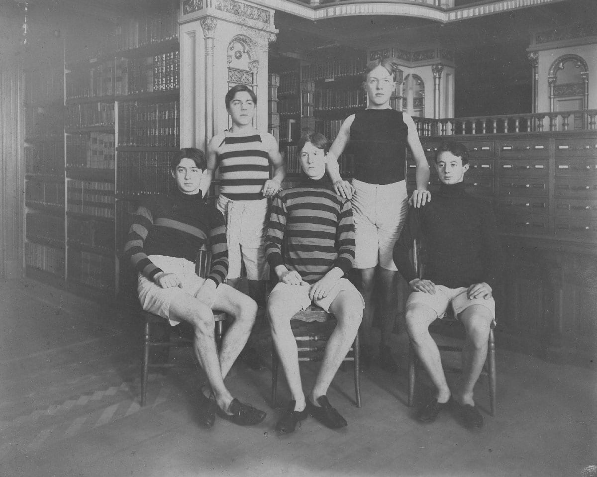 Members of Georgetown University's track team, complete with running shoes, pose somewhat incongruously in front of the card catalog in Riggs Library