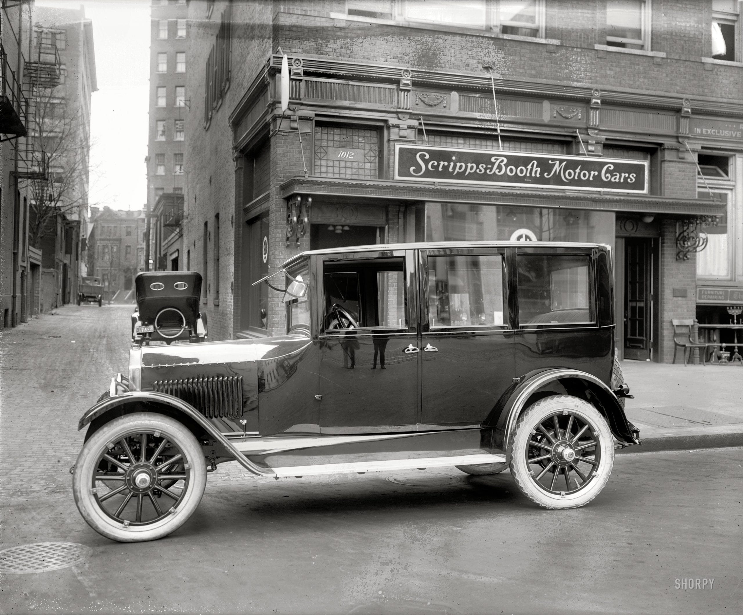 "Washington, D.C, 1921. ""Scripps-Booth Sales Co., 14th Street N.W."" And one very shiny sedan. National Photo Company Collection glass negative."