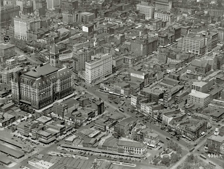 "Washington, D.C., circa 1922. ""Star Building from air."" The Washington Star newspaper building at the center is at the intersection of 11th Street N.W. and Pennsylvania Avenue, which runs diagonally across the photo. The big building with the tower us the Old Post Office. There's a lot to see here, including laundry hung out to dry. National Photo Company glass negative."