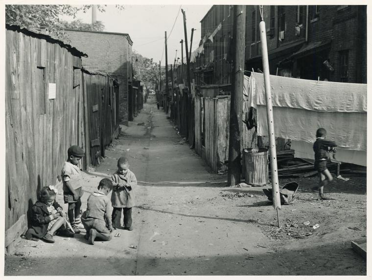 Children playing in the Defrees Alley, NE Washington, D.C.; Near Capitol Building; One basement room rents for $9.00 a month, two rooms upstairs for $ 16.00, one bath and cold water in the hall for entire building.. Wolcott, Marion Post -- Photographer
