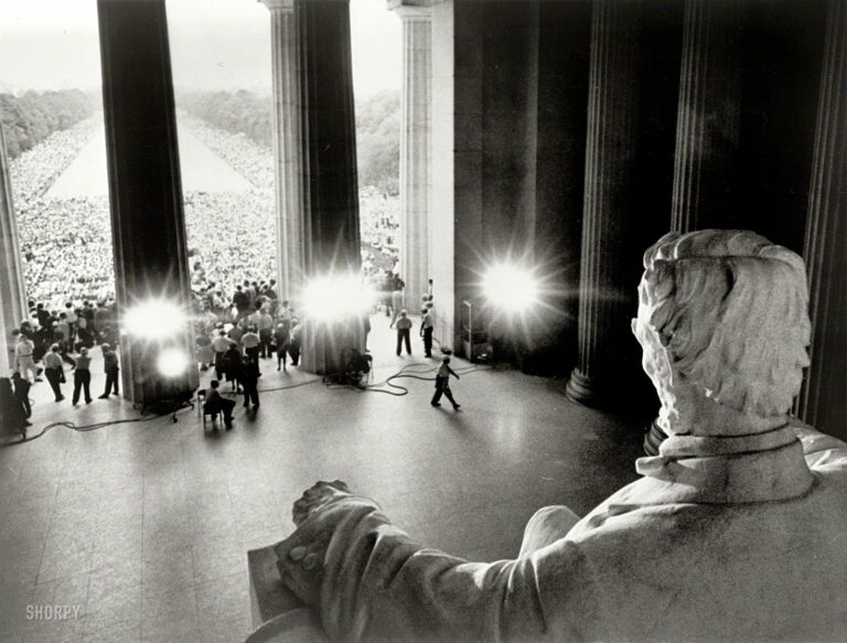 """August 28, 1963. """"Emancipator looking down on demonstrators. Participants in the March on Washington in front of the Lincoln Memorial and massed along both sides of the Reflecting Pool, viewed from behind Abraham Lincoln statue."""" Photo by James K. Atherton for United Press International."""