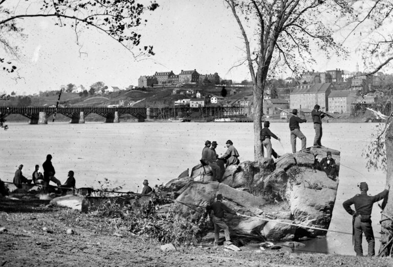 Union soldiers guarding the Potomac River in Washington, DC in 1861. Georgetown University is visible in the background. Photo by George Barnard