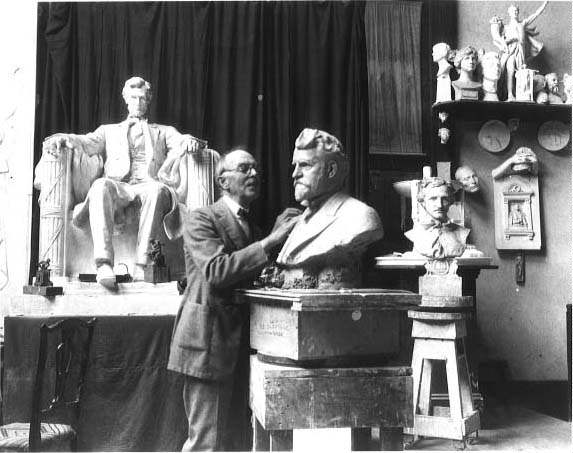 Picture of Daniel Chester French in his studio with Lincoln Memorial statue in the background