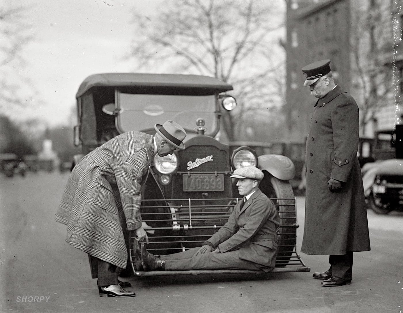 "December 17, 1924. Washington, D.C. ""Auto safety device demonstration. Inspector Albert Headley."" National Photo glass negative."