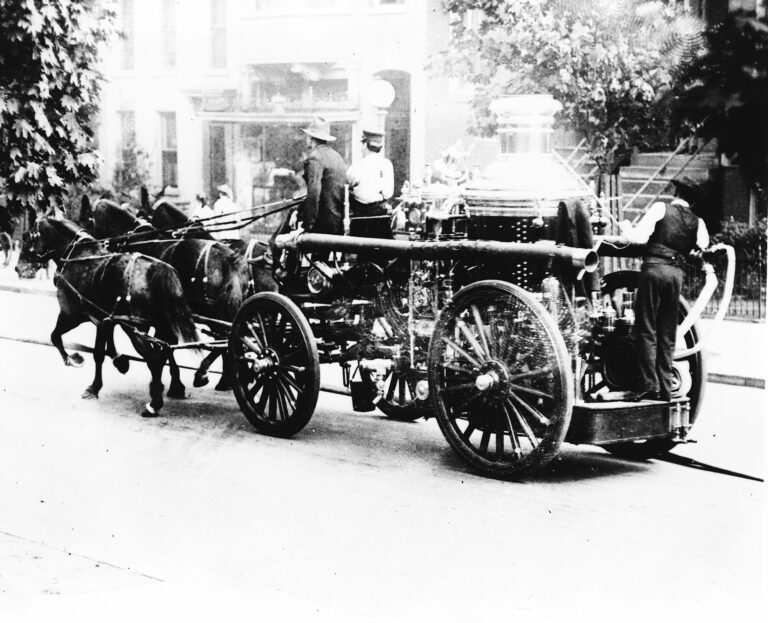 Three firemen on fire engine drawn by three horses, Washington, D.C.