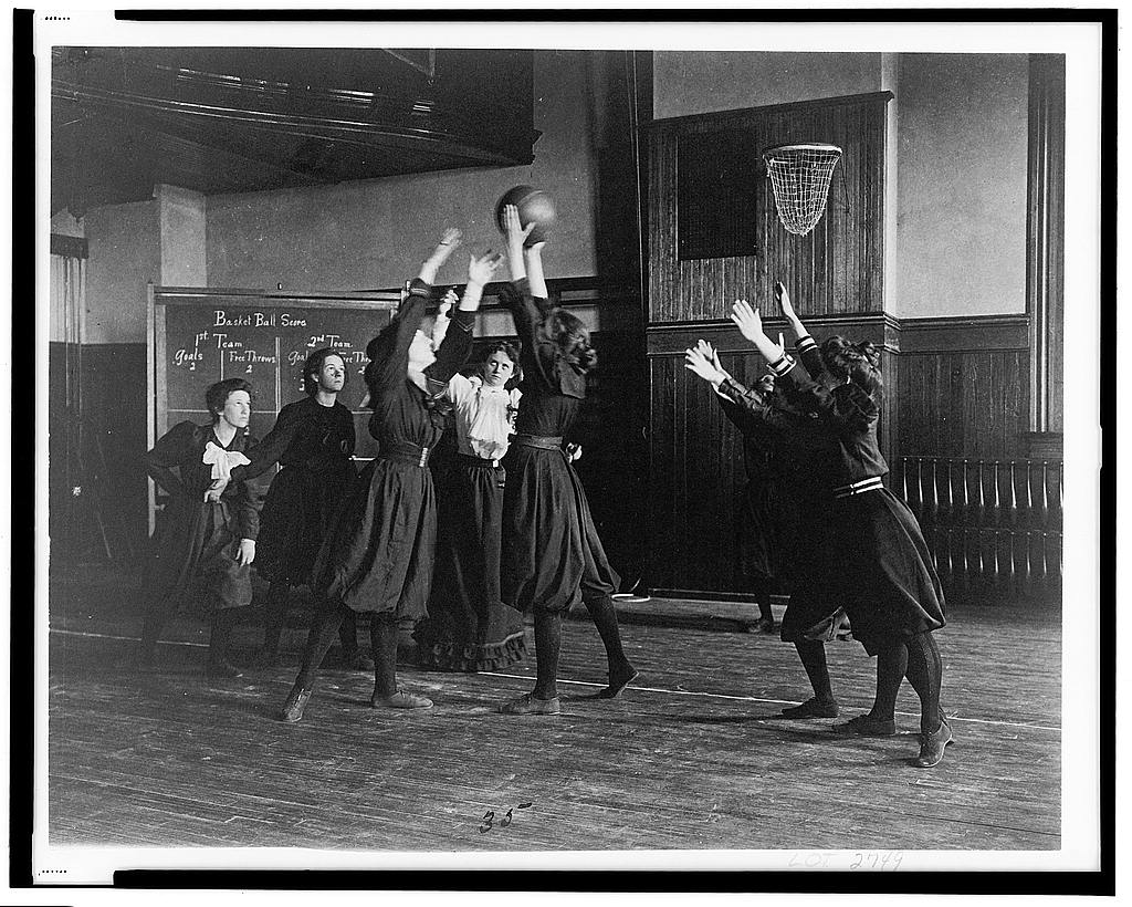 Women at Western High School playing basketball