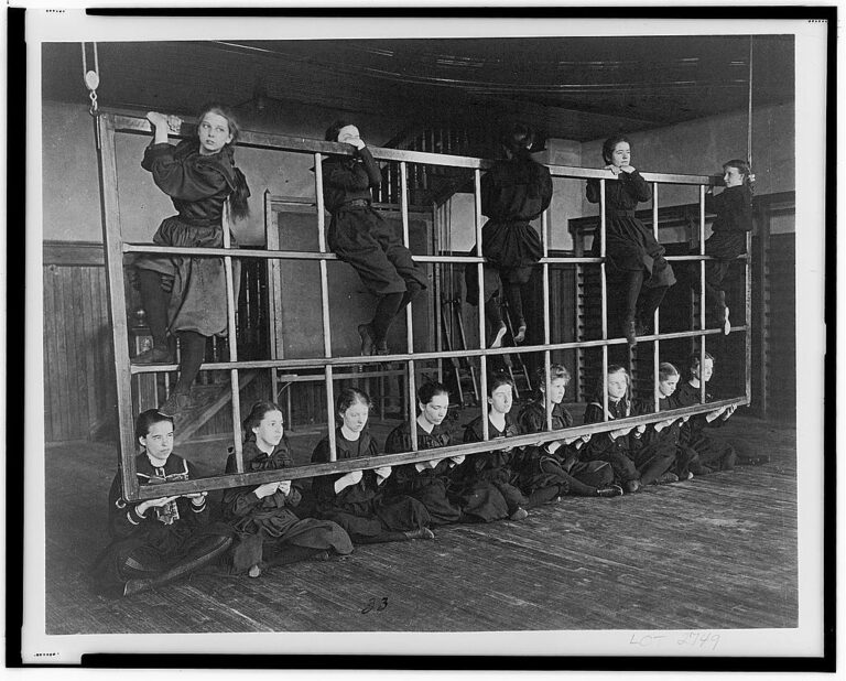 Women at Western High School posing on an exercise device