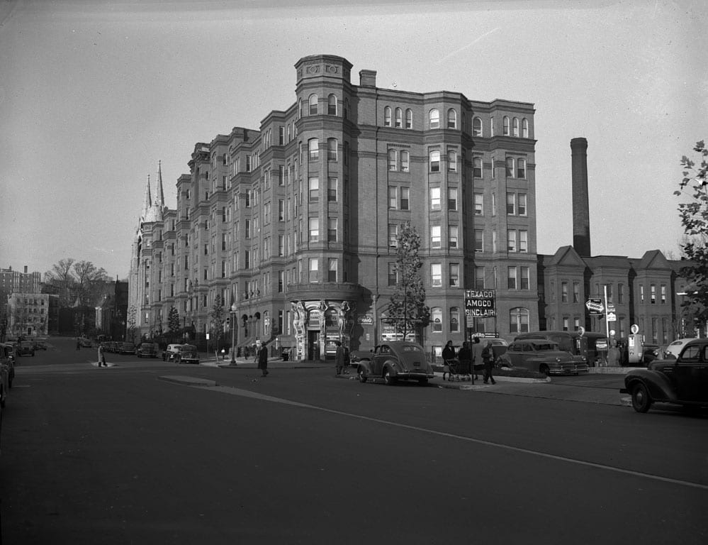 "The Dunbar Hotel, located on 15th street between U and V streets NW. Designed by Clement A. Didden, Jr. the hotel had 485 bedrooms. Demolished in 1974. Automobiles are shown on the street, pedestrians on the sidewalk, and a gas station with a ""Texaco / Amoc / Sinclair"" sign. ""Ansco Safety Film"" edge imprint. Negative uncaptioned."