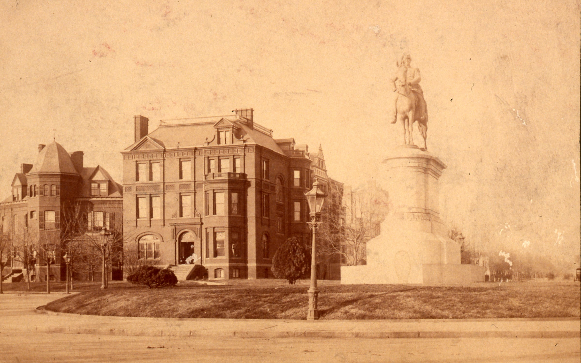 View northwest past the equestrian statue (by Henry Kirke Brown) of General Winfield Scott. Includes the Queen Anne-style Windom House on the northwest corner of Massachusetts Avenue and 16th Street NW, and the Hutchins House next door to the west. (Current site of the Australian Embassy). William H. Seaman Photograph Collection, HSW (1888)