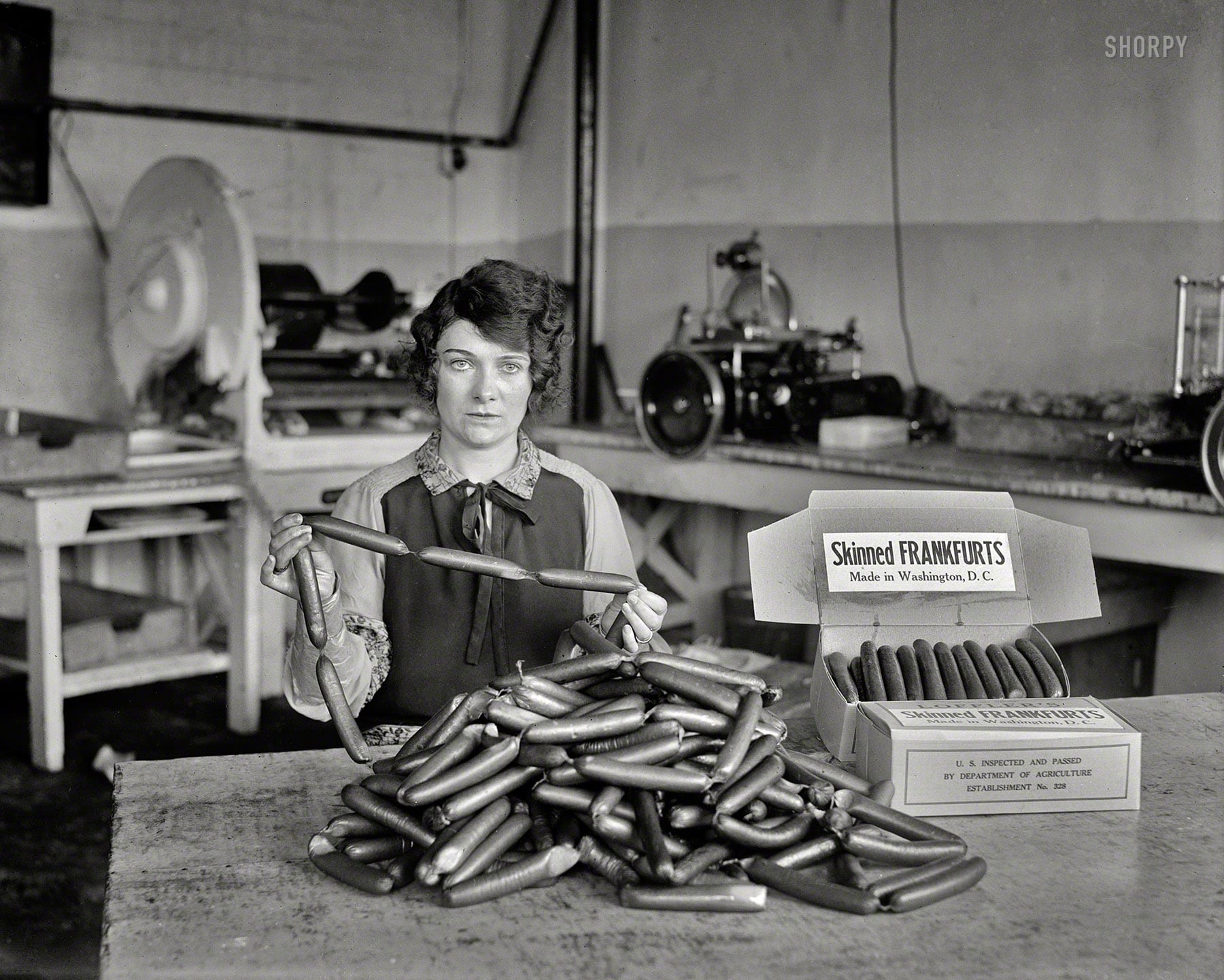 """1927. """"Skinned frankfurts, made in Washington, D.C."""" What Bismarck said about laws and sausages: It turns out you can watch them (or not watch them) being made in the same place. Harris & Ewing glass negative."""