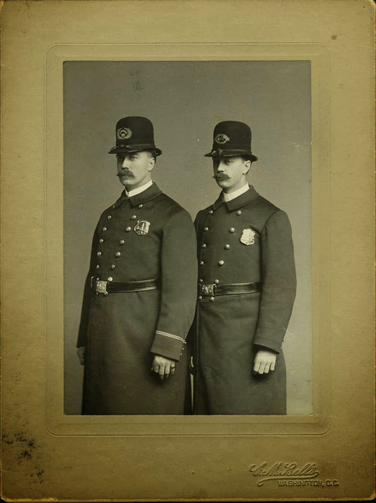 Brothers J.L. and J.F. Sprinkle wearing their DC  Metropolitan Police Department uniforms, 1904. Collection of the National Law Enforcement Museum, 2006.166.1
