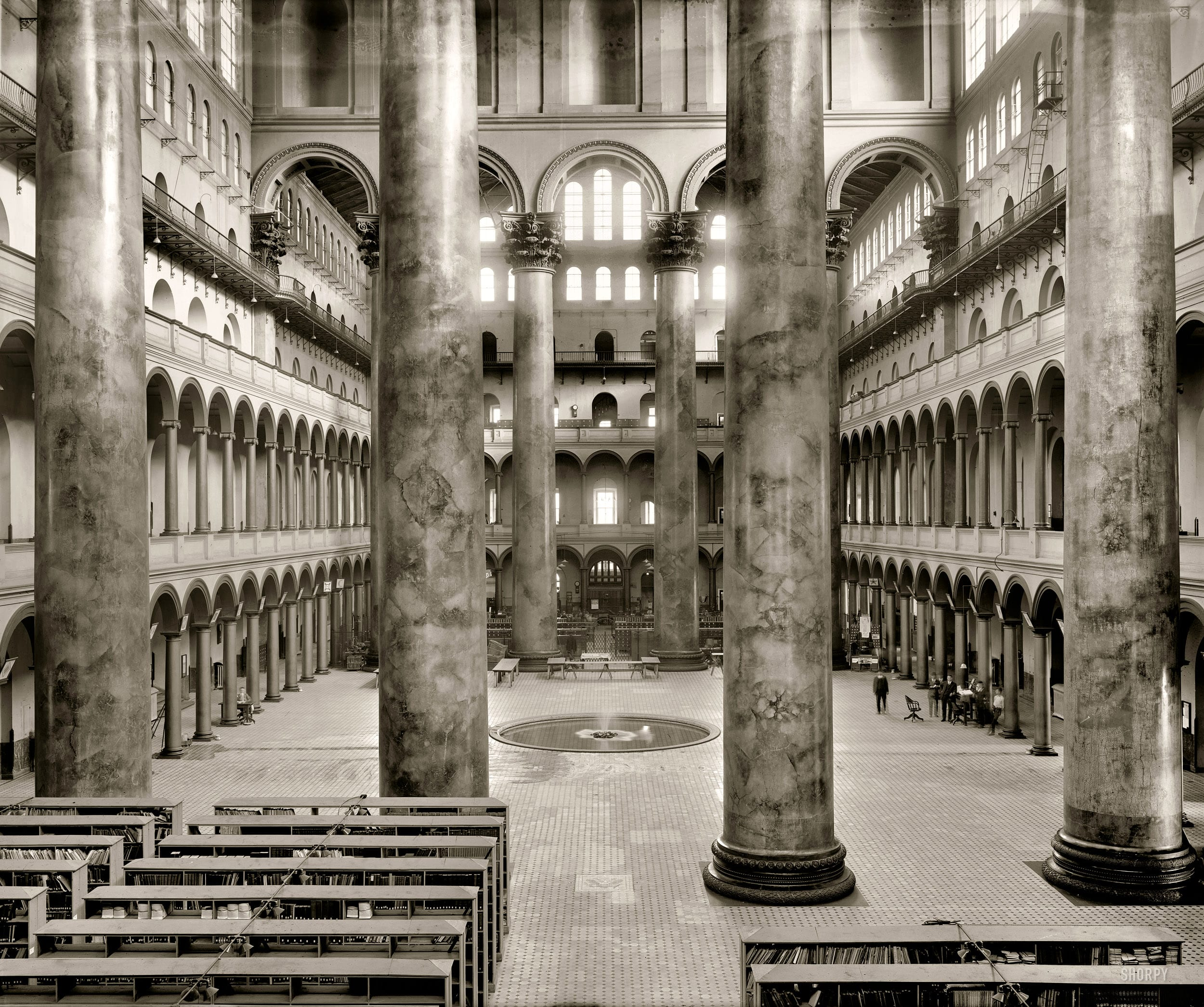 """Washington, D.C., circa 1918. """"Pension Office interior."""" This former repository of Civil War veterans' pension records is now the National Building Museum. National Photo Company Collection glass negative."""