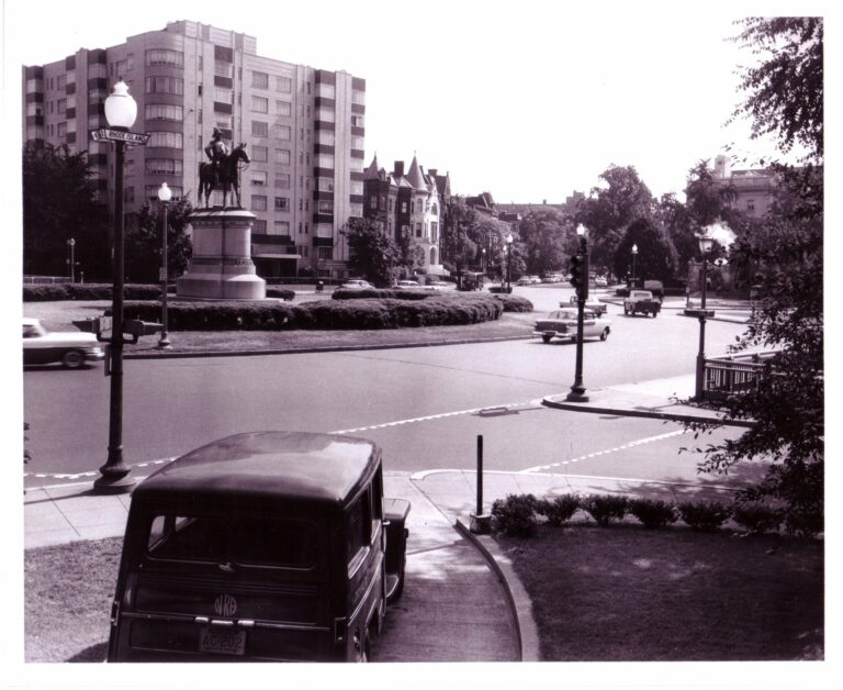 Scott Circle, NW, looking northeast from Rhode Island Avenue with statue of Gen. Winfield Scott; note glass street sign under globe. (July 8, 1950