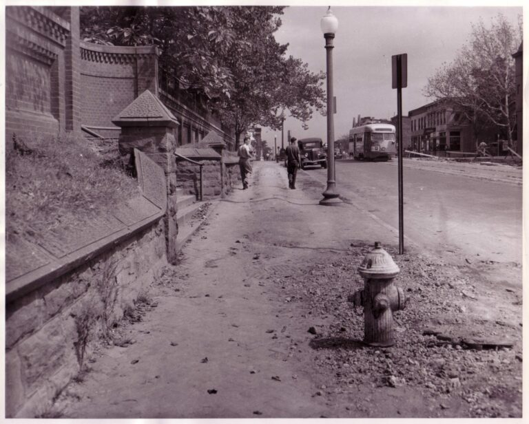 At 3rd & H Streets, NE, a streetcar passes an unpaved sidewalk and no-longer existing wall, September 1947