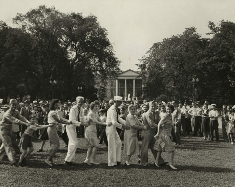 Jubilant crowd on V-J day dancing on the White House lawn