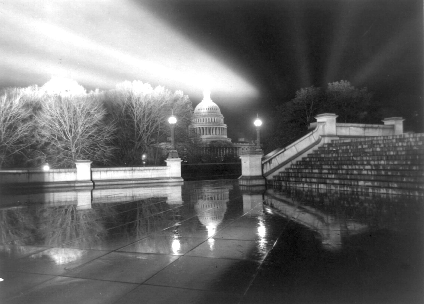 Night view in rain [of Capitol] taken from steps [Neptune Plaza] of Library of Congress