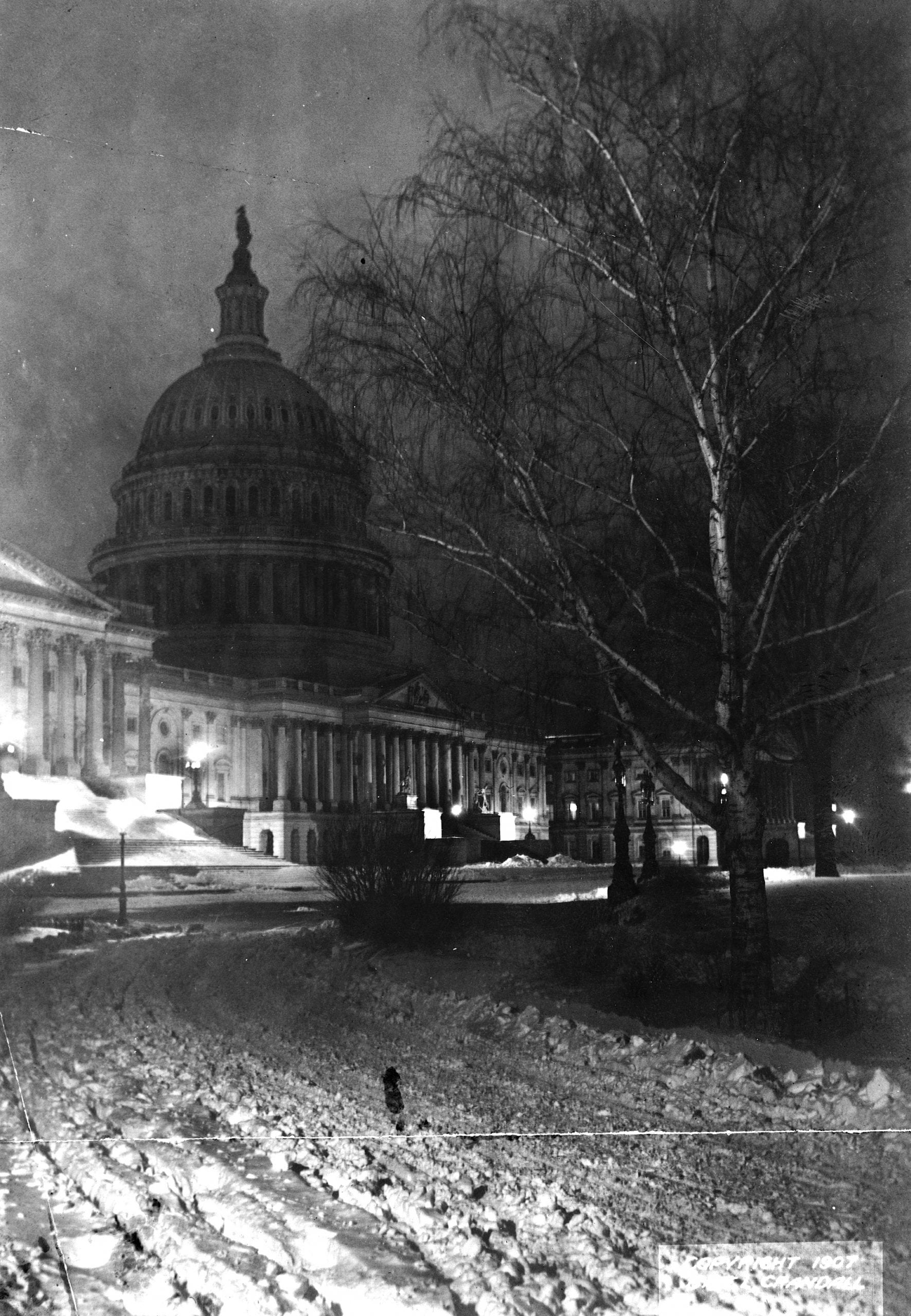 view of the Capitol at night in the snow (1907)