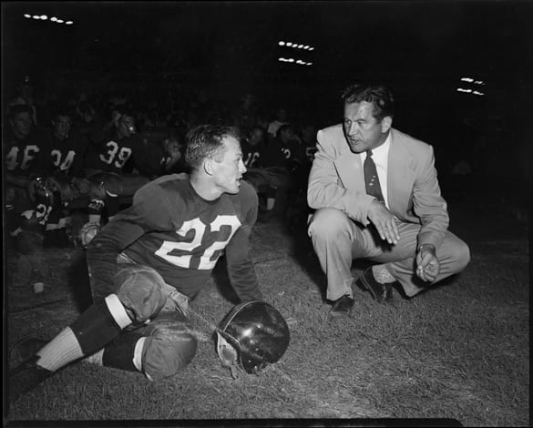 "Charlie ""Choo Choo"" Justice on sidelines with Washington Redskins head coach Joe Kuharich during game versus the Green Bay Packers at Riddick Stadium, Raleigh, N.C., September 11, 1954"