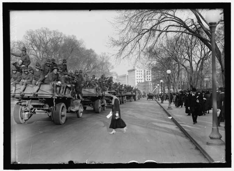 soldiers rolling through Washington on trucks