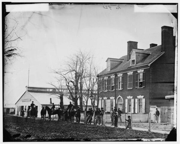 """Quarters of General Alfred Pleasonton, and """"Government Horse Shoeing Shop"""" at Left, 21st St. near F NW - Washington, D.C., April 1865"""