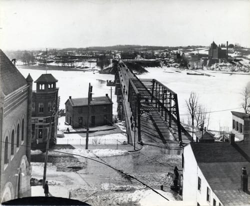 View of Aqueduct Bridge and Rosslyn from Georgetown, ca. 1900. The American Brewery is located in upper right. (Arlington Public Library)