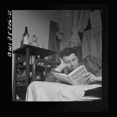 A clerk in the U.S. Navy Department reading in his room in a boardinghouse